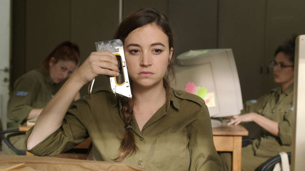 """Daffi (Nelly Tagar) can't stand her life and wants to be transferred from a desert outpost to Tel Aviv in the Israeli comedy """"Zero Motivation,"""" about three women serving their two-year military service."""