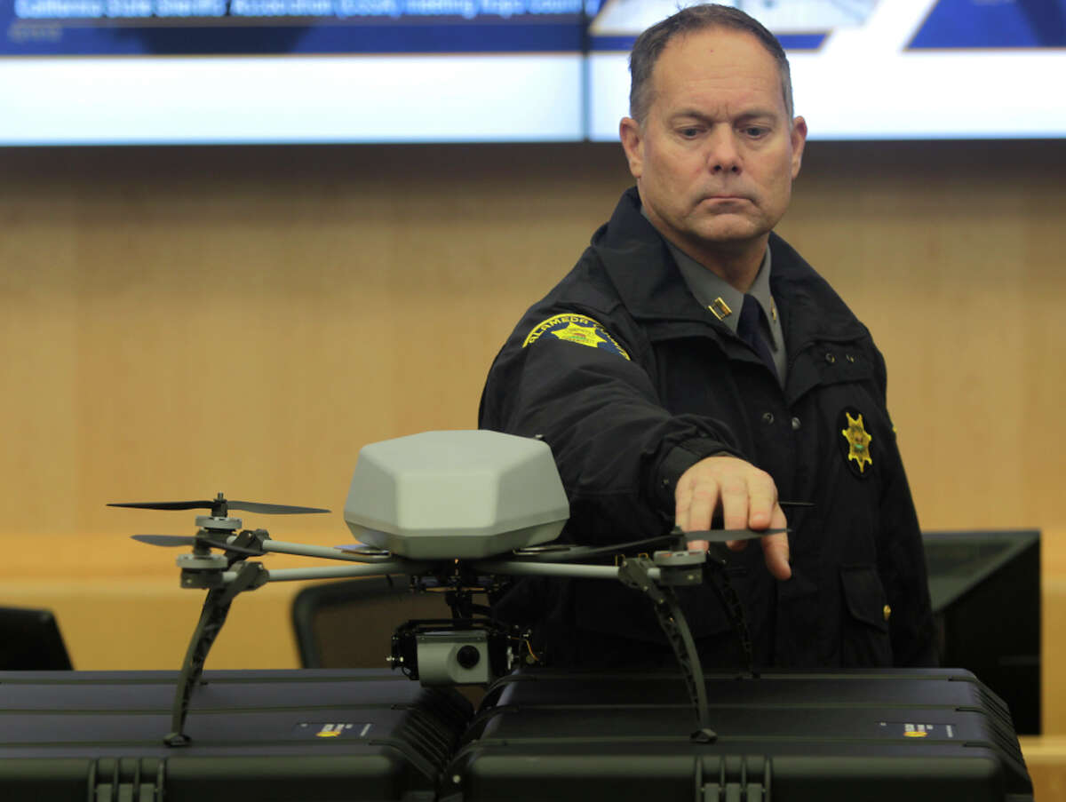 Alameda County Sheriff's Capt. Dave Brady twirls a propeller on one of the department's new drones in Dublin on Wednesday.