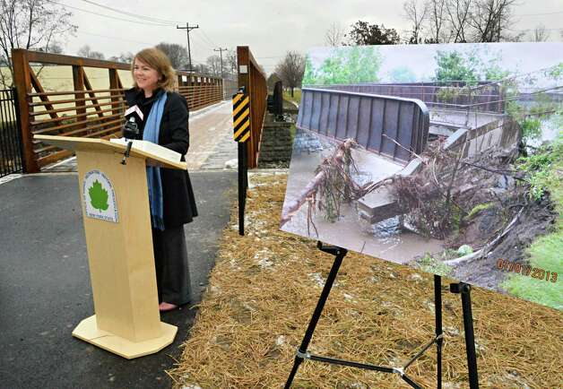 Alane Ball Chinian, Regional Director New York State Office of Parks, Recreation and Historic Preservation speaks during ceremonies to mark the reopening of the newly reconstructed Erie Canalway Bridge over the Otsquago Creek Wednesday Dec. 3, 2014, in Fort Plain, NY.  (John Carl D'Annibale / Times Union) Photo: John Carl D'Annibale / 00029707A