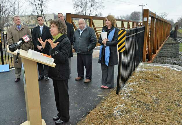 Executive director of Parks and Trails New York Robin Dropkin speaks during ceremonies to mark the reopening of the newly reconstructed Erie Canalway Bridge over the Otsquago Creek Wednesday Dec. 3, 2014, in Fort Plain, NY.  (John Carl D'Annibale / Times Union) Photo: John Carl D'Annibale / 00029707A
