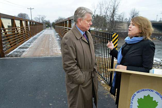 Brian Stratton, left, Director, New York State Canal Corp., and Alane Ball Chinian, Regional Director New York State Office of Parks, Recreation and Historic Preservation during ceremonies to mark the reopening of the newly reconstructed Erie Canalway Bridge over the Otsquago Creek Wednesday Dec. 3, 2014, in Fort Plain, NY.  (John Carl D'Annibale / Times Union) Photo: John Carl D'Annibale / 00029707A