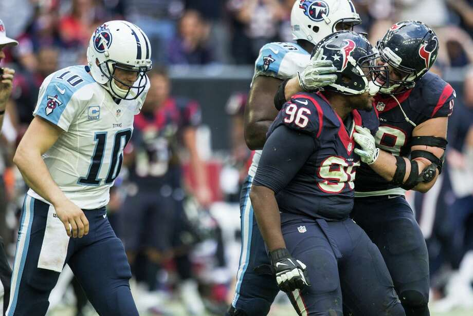 Houston Texans defensive end Tim Jamison (96) and defensive end J.J. Watt (99) a celebrate Jamison's sack of Tennessee Titans quarterback Jake Locker during the third quarter. Photo: Brett Coomer, Staff / Houston Chronicle / © 2014  Houston Chronicle