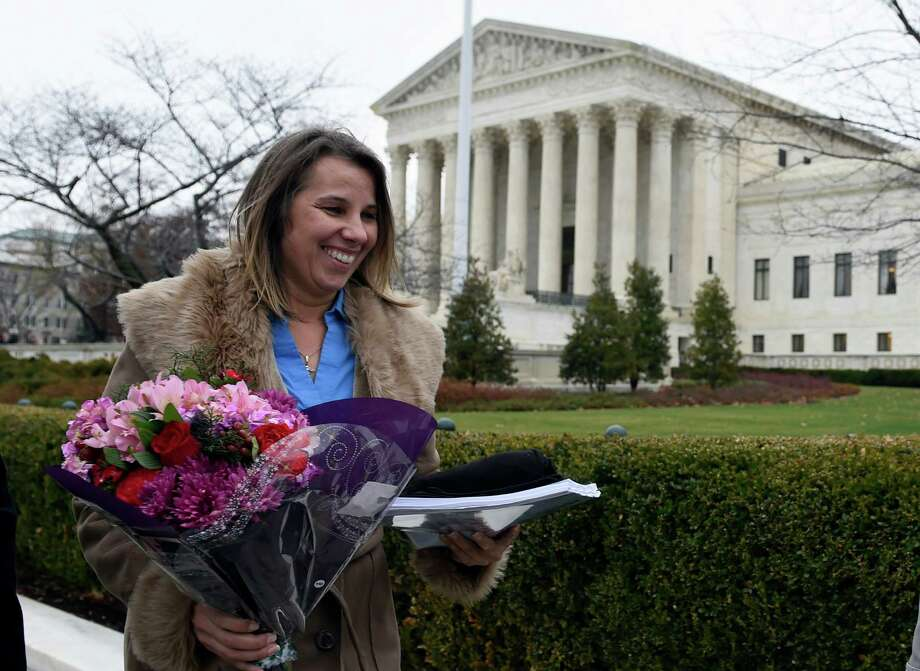 Peggy Young, a Virginia woman who lost her UPS job after she became pregnant, leaves the Supreme Court. Justices are weighing how much employers must do to accommodate pregnant workers. Photo: Susan Walsh, STF / AP