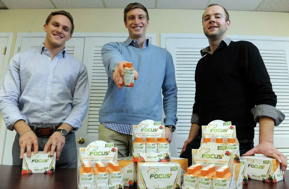 Parker Kligerman, Ian O'Connell and Jeff Moss, from left, have recently launched a new supplement, Focus Plus, a 2-ounce shot designed to improve focus, mental clarity and cognition. Photo: Autumn Driscoll / Connecticut Post