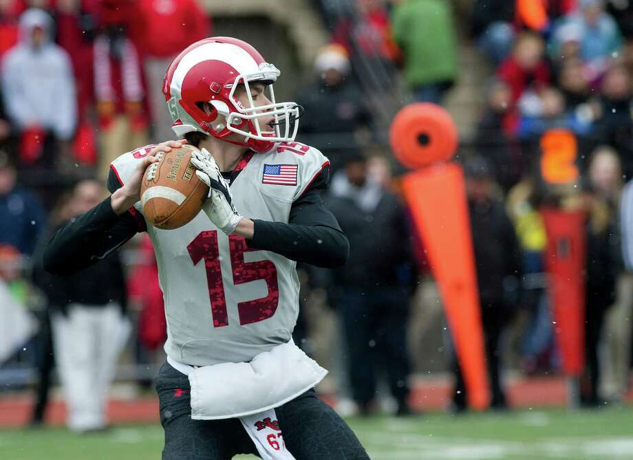 New Canaan's Michael Collins throws a pass during the FCIAC championship game between New Canaan High School and Darien High School in Stamford, Conn., on Thanksgiving Day, Thursday, November 27, 2014. Photo: Lindsay Perry / Stamford Advocate
