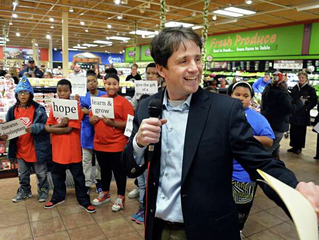 Boys & Girls Clubs of Schenectady executive director Shane Baggy speaks after members of the Boys & Girls Club performed a GivingTuesday flash mob dance at the Price Chopper on Altamont Ave. Tuesday Dec. 2, 2014, in Schenectady, NY.   (John Carl D'Annibale / Times Union) Photo: John Carl D'Annibale / 00029665A