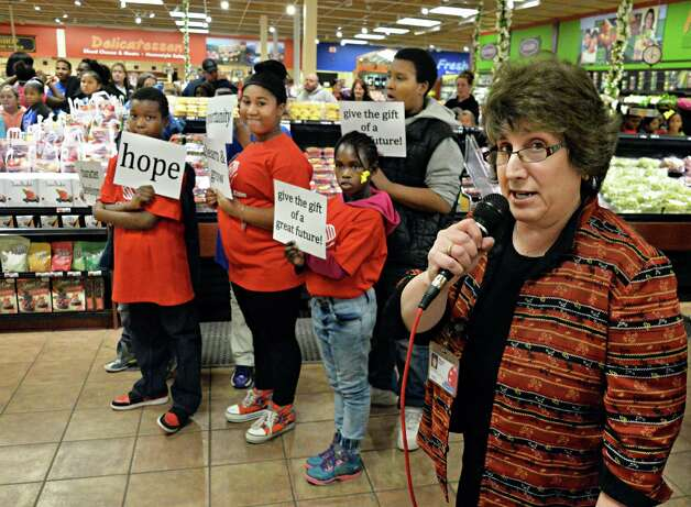 Price Chopper's Mona Golub speaks after members of the Boys & Girls Clubs of Schenectady performed a GivingTuesday flash mob dance at the Price Chopper on Altamont Ave. Tuesday Dec. 2, 2014, in Schenectady, NY.   (John Carl D'Annibale / Times Union) Photo: John Carl D'Annibale / 00029665A