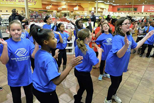 Members of the Boys & Girls Clubs of Schenectady perform a GivingTuesday flash mob dance at the Price Chopper on Altamont Ave. Tuesday Dec. 2, 2014, in Schenectady, NY.   (John Carl D'Annibale / Times Union) Photo: John Carl D'Annibale / 00029665A