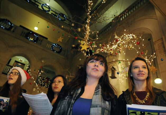 Albanettes, left to right, Michaela Tuzzolo, Dawn Dinh, Abbi Roy and Helen Conroy of Albany High School sing holiday songs during the City of Albany tree lighting on Wednesday Dec. 3, 2014 in Albany, N.Y.  (Michael P. Farrell/Times Union) Photo: Michael P. Farrell / 00029654A