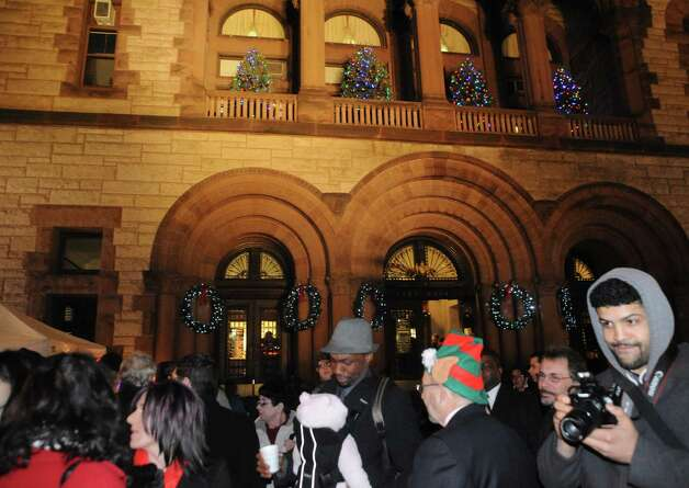 Attendees gather in front of City Hall for the city of Albany tree lighting on Wednesday Dec. 3, 2014 in Albany, N.Y.  (Michael P. Farrell/Times Union) Photo: Michael P. Farrell / 00029654A