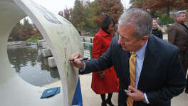 San Antonio Water System President/CEO Robert R. Puente signs a 54-inch diameter pipe Dec. 3, 2014, at an event held at announcing the launch of the new Vista Ridge water project. The pipe represents the width of the actual pipe used in the first part of the 142-mile pipeline running from Burleson County to San Antonio. On Tuesday, Abengoa Vista Ridge, the company that is supposed to build the pipeline, said it needs new financial backers.