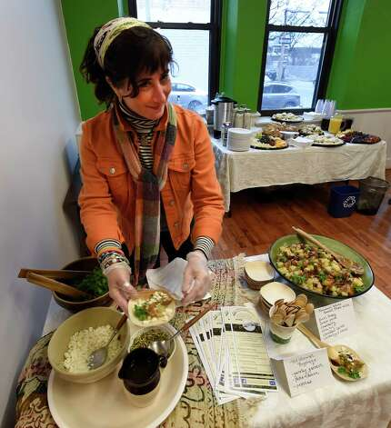 Renee Panetta of the Chef's Consortium was on hand to make dishes for the grand opening of the Capital District Community Gardens' Urban Grow Center Wednesday morning, Dec. 3, 2014, in Troy, N.Y. (Skip Dickstein/Times Union) Photo: SKIP DICKSTEIN / 00029638A