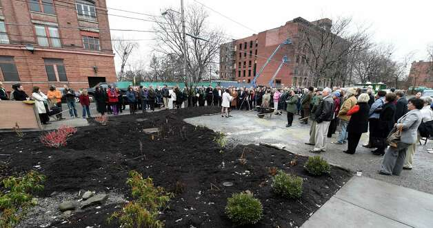 A large crowd was on hand for the grand opening of the Capital District Community Gardens' Urban Grow Center Wednesday morning, Dec. 3, 2014, in Troy, N.Y.  (Skip Dickstein/Times Union) Photo: SKIP DICKSTEIN / 00029638A