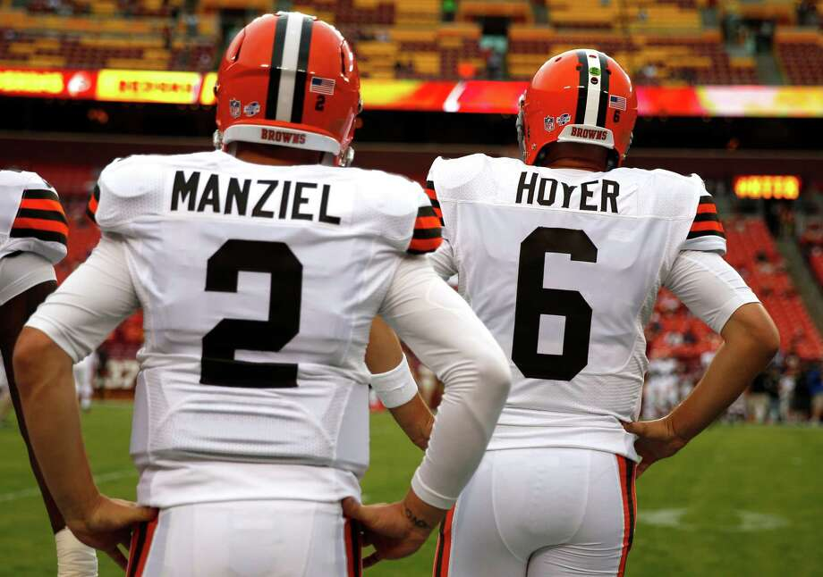For at least another week, Johnny Manziel, left, will be appropriately numbered as the Browns' backup quarterback behind Brian Hoyer. Photo: Evan Vucci, STF / AP