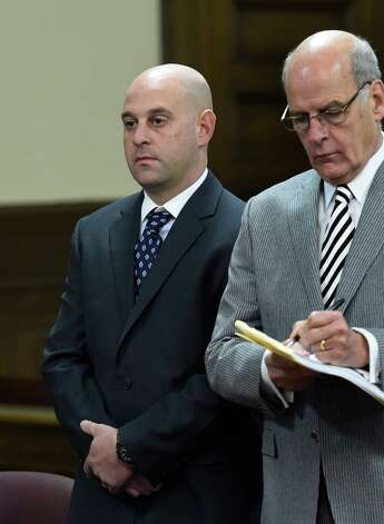 Troy patrolman Brian Gross, left, stands with his attorney Stephen Coffey, right, for his arraignment at the Rensselaer County Courthouse Wednesday morning, Dec. 3, 2014, in Troy, N.Y.  (Skip Dickstein/Times Union) Photo: SKIP DICKSTEIN / 00029725A