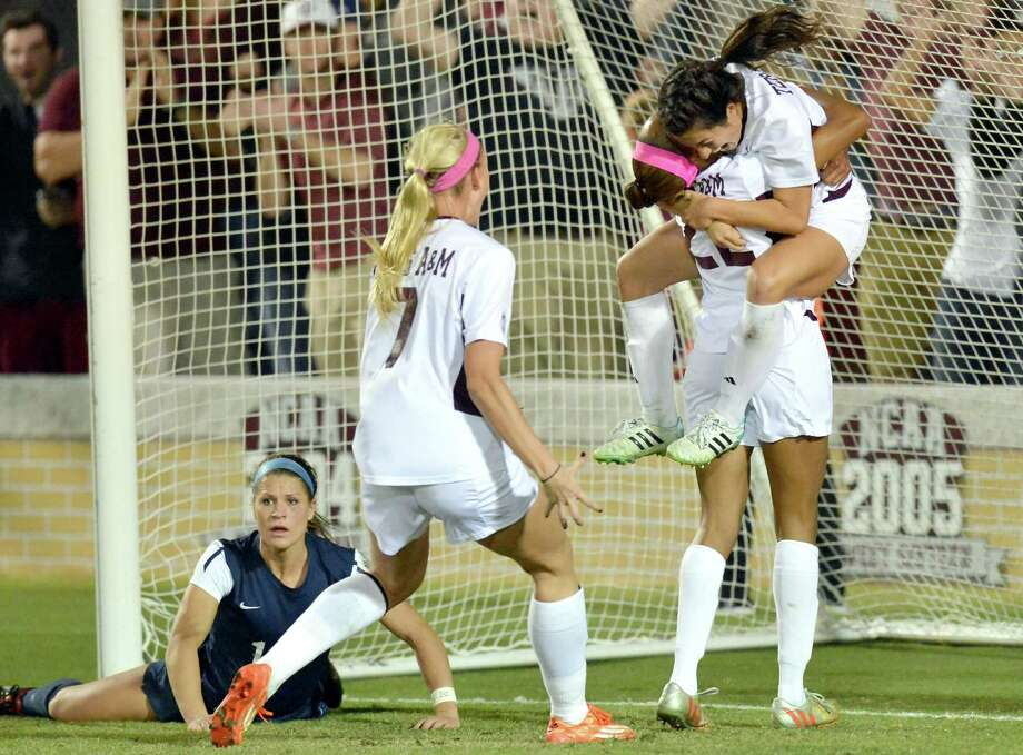 Texas A&M's Allie Bailey was in a celebratory mood Saturday, jumping into the arms of teammate Bianca Brinson after scoring her second goal in the Aggies' 2-1 win over Penn State in their Elite Eight matchup. Photo: Sam Craft/The Bryan-College Stat, MBR / AP