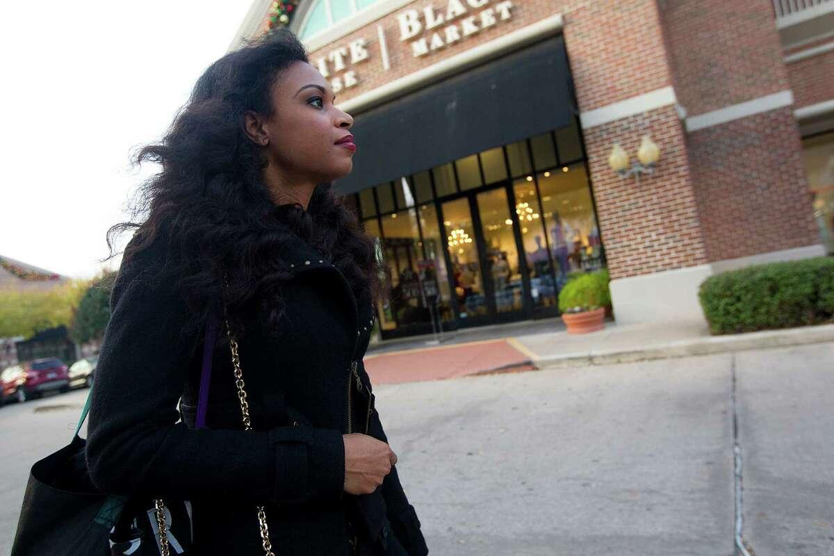 Khaya Laidley walks through the Rice Village Arcade after getting off work Wednesday, Dec. 3, 2014, in Houston. ( Johnny Hanson / Houston Chronicle )