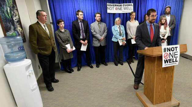Issac Silberman-Gorn, community organizer with Citizen Action of New York based in Binghamton, joins with fellow anti-fracking activists in calling for Gov. Cuomo to impose a three to five year moratorium on fracking Wednesday morning, Dec. 3, 2014, during a press conference at the Legislative Office Building in Albany, N.Y.  (Skip Dickstein/Times Union) Photo: SKIP DICKSTEIN / 00029721A