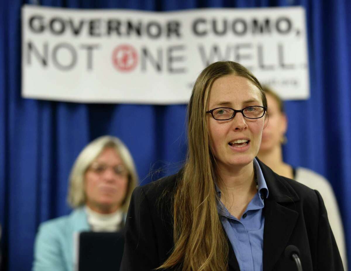 Julia Walsh of Frack Action joins with other anti-fracking activists in calling for Gov. Cuomo to impose a three to five year moratorium on fracking Wednesday morning, Dec. 3, 2014, during a press conference at the Legislative Office Building in Albany, N.Y. (Skip Dickstein/Times Union)