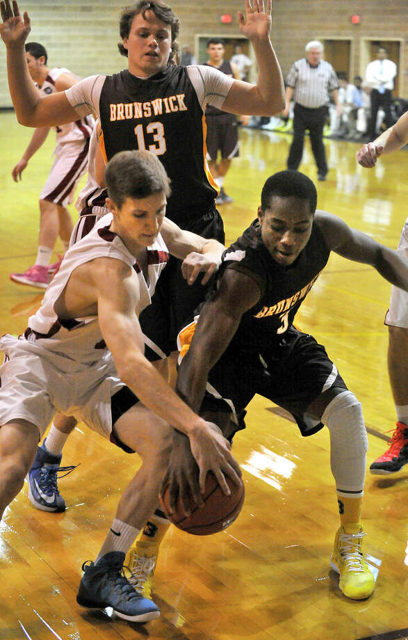 Taft's David Gayas and Brunswick's Nacho Nwana compete for the loose ball during their basketball game at the Brunswick School's lower and middle school campus in Greenwich, Conn., on Wednesday, Dec. 3, 2014. Taft won, 62-52. Photo: Jason Rearick / Stamford Advocate