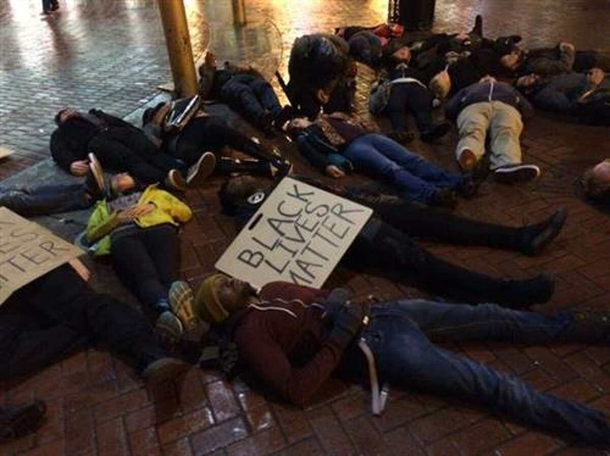 Protesters lie on the ground near the Powell St. cable car turnaround in San Francisco on Wednesday, Dec. 3, 2014, in protest of a grand jury's decision not to indict an NYPD officer in the chokehold death of Eric Garner.