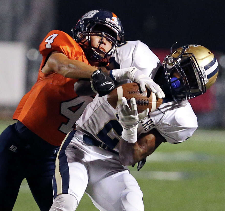 O'Connor's Darryl Godfrey tries to shake the tackle of Brandeis' Ryo Onoue on a pass play during first-half action on Oct. 24 at Farris Stadium. Photo: Edward A. Ornelas, Staff / San Antonio Express-News / © 2014 San Antonio Express-News