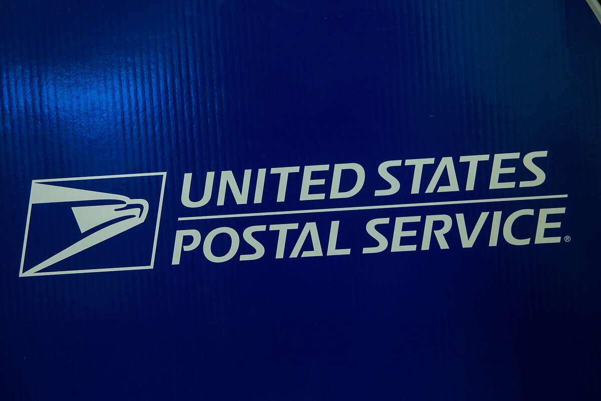 FILE - NOVEMBER 10, 2014: It was reported that alleged Chinese hackers compromised the data of hundreds of thousands of U.S. Postal Service employees in recent network breach November 10, 2014. NEW YORK, NY - SEPTEMBER 25: Signage for the United States Post Office (USPS) is seen on September 25, 2013 in New York City. The USPS announced today that they're considering raising the price of stamps by 3 cents. (Photo by Andrew Burton/Getty Images)