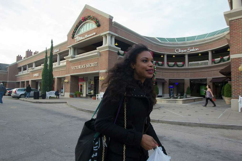 Khaya Laidley walks near the Rice Village Arcade, which is about to get a makeover. Photo: Johnny Hanson, Staff / © 2014  Houston Chronicle