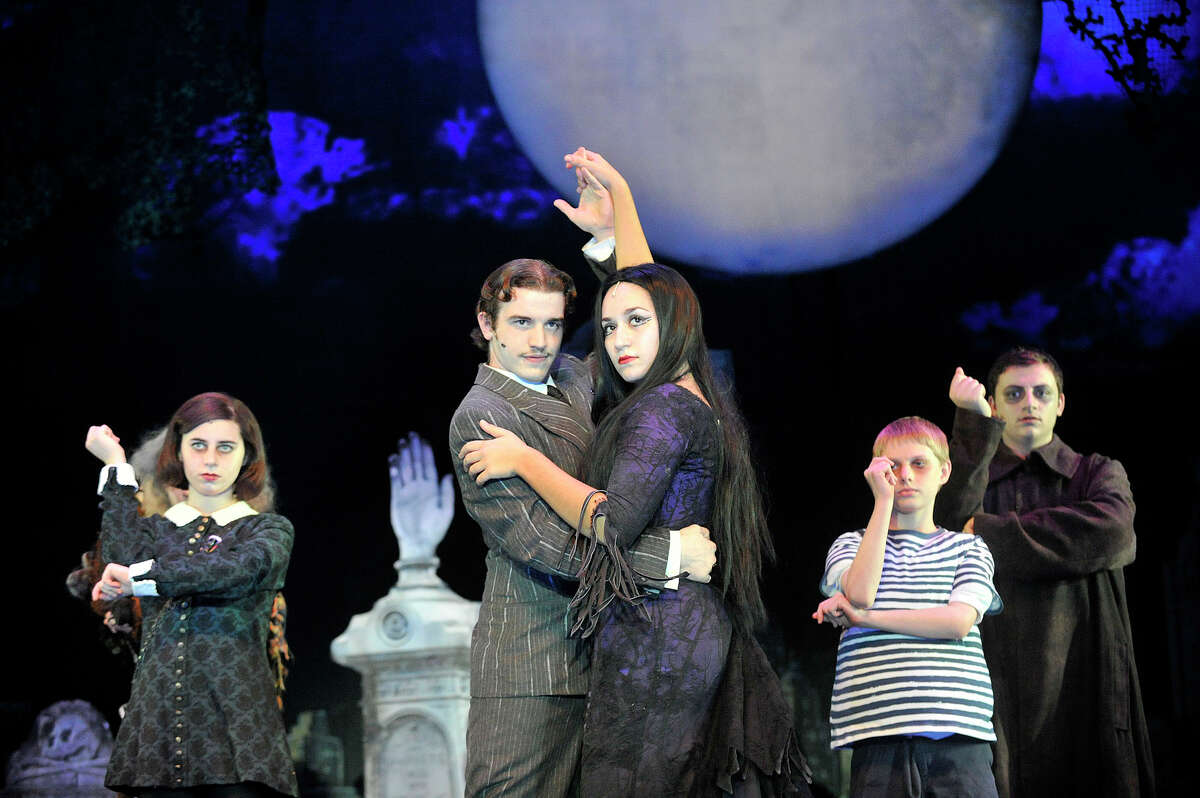 Actors playing from left: Wednesday Addams, Gomez Addams, Morticia Addams, Pugsley Addams and Uncle Fester played respectively by Julianna Goldfluss, Roberto Corso, Madeline Bria, Hoyt Drynan and Will Bruno perform during the Stamford All-School Musical dress rehearsal performance of The Addams Family musical at Rippowam Middle School in Stamford, Conn., on Tuesday, Dec. 2, 2014. There will be five performances - December 6, 12, 13 and 14 at 7:30 p.m. and December 7 and 14 at 3 p.m. with a special Meet the Cast event following the December 7 matinee. For more information and to purchase tickets go to www.StamfordAllSchoolMusical.org.