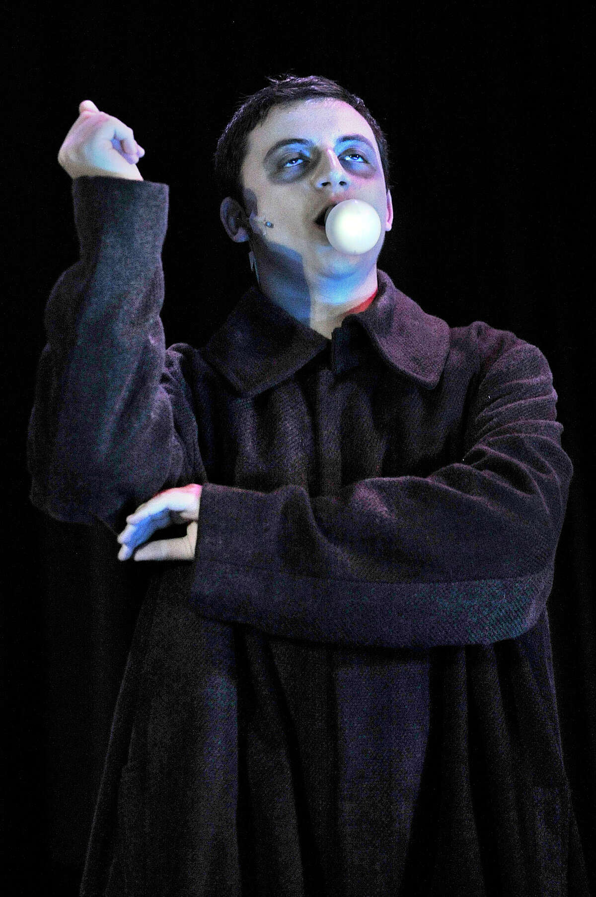 Will Bruno, playing Uncle Fester, gets a light bulb to illuminate as he holds it in his mouth during the Stamford All-School Musical dress rehearsal performance of The Addams Family musical at Rippowam Middle School in Stamford, Conn., on Tuesday, Dec. 2, 2014. There will be five performances - December 6, 12, 13 and 14 at 7:30 p.m. and December 7 and 14 at 3 p.m. with a special Meet the Cast event following the December 7 matinee. For more information and to purchase tickets go to www.StamfordAllSchoolMusical.org.