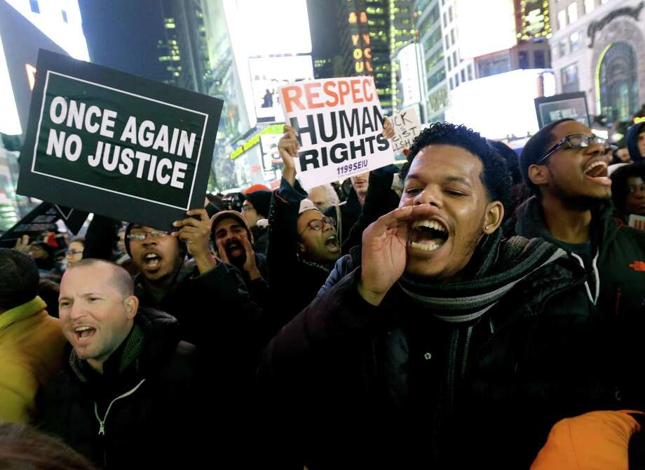Protesters flock to Times Square after it was announced that a New York police officer would not be indicted in the chokehold death of Eric Garner. Photo: Julio Cortez, STF / AP