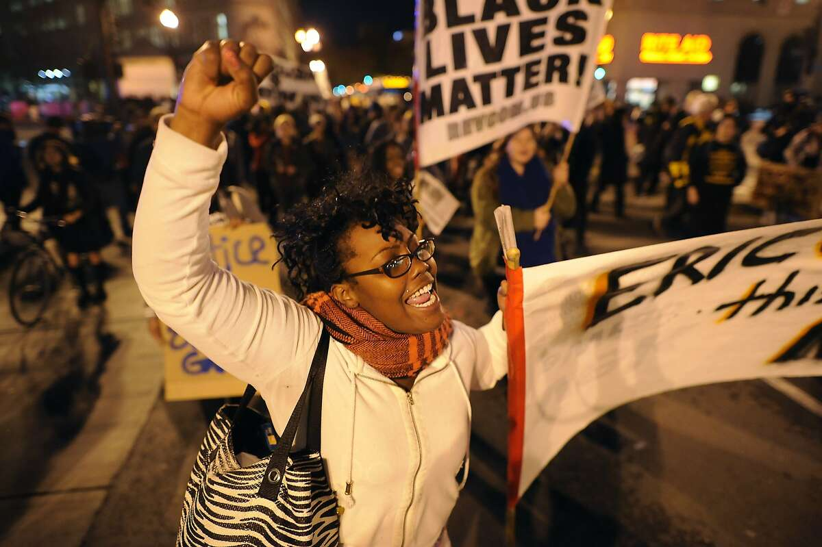 Sharlana Turner yells while marching down Broadway during a demonstration in Oakland, CA, on Wednesday, December 3, 2014, protesting a grand jury decision not to indict an NYPD police officer that killed Eric Garner, a black man, by putting him into a chokehold during an arrest in July.