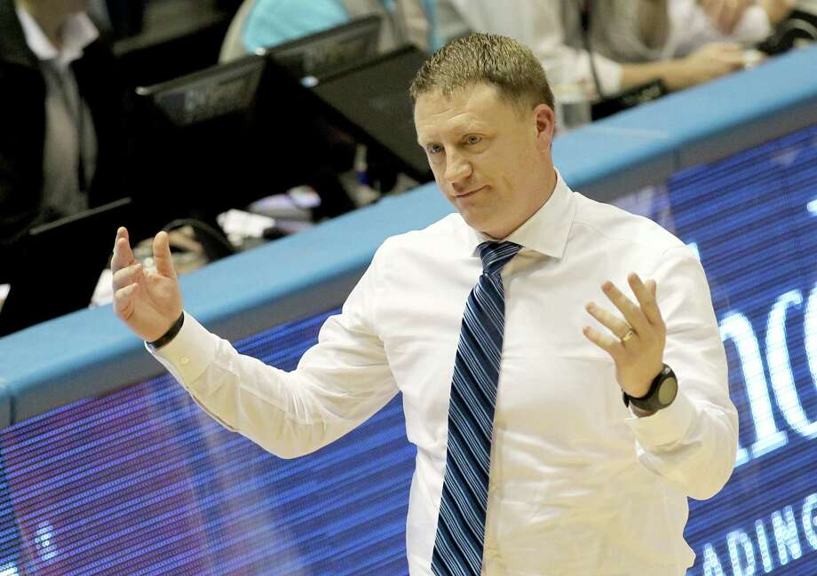 Rice Owls head coach Mike Rhoades argues a call against the Houston Baptist Huskies in the second  half on Wednesday, December 3, 2014 at the Tudor Fieldhouse at Rice University in Houston, TX. HBU won 58 to 55. Photo: Thomas B. Shea, For The Chronicle / © 2014 Thomas B. Shea