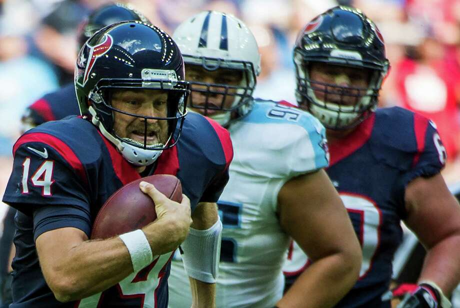 Texans quarterback Ryan Fitzpatrick, left, used his arm (six TD passes) much more than his legs (10 yards) to earn AFC Offensive Player of the Week honors. Photo: Smiley N. Pool, Staff / © 2014  Houston Chronicle