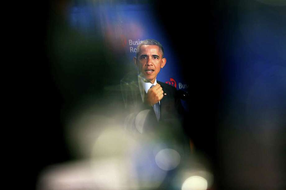 WASHINGTON, DC - DECEMBER 3:  (AFP OUT) U.S. President Barack Obama delivers remarks at the quarterly meeting of the Business Roundtable (BRT) at the Business Roundtable Headquarters on December 3, 2014. in Washington, DC. BRT is an association of chief executive officers of leading U.S. companies working to promote sound public policy and a thriving U.S. economy. Obama told the CEOs he wants wages to grow at a time when corporate profits are at a 60-year high.  (Photo by Aude Guerrucci-Pool/Getty Images) Photo: Pool / 2014 Getty Images