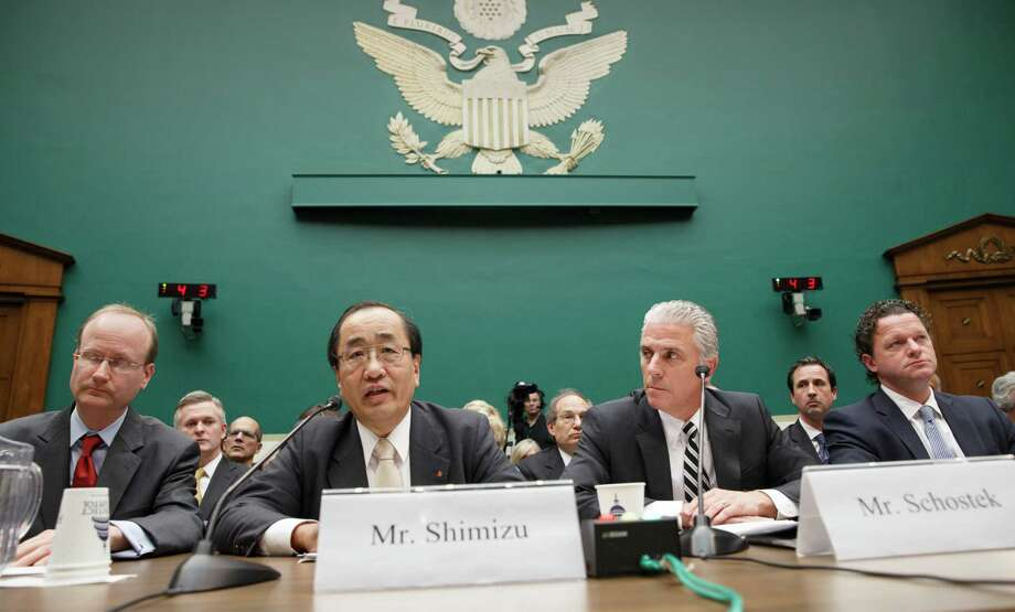 Hiroshi Shimizu, senior vice president of global quality assurance at Takata, center, left, joined at right by Rick Schostek, executive vice president of Honda North America, and Craig Westbrook, vice president for aftersales for BMW of North America, far right, testifies on Capitol Hill in Washington Wednesday, Dec. 3, 2014, before the House Commerce, Manufacturing, and Trade subcommittee hearing to examine ruptures and recalls of defective air bags made by Takata. The air bags, made by Japanese supplier Takata Corp., can explode with too much force, sending metal shrapnel into the passenger compartment. Takata insists that current recalls covering 8 million U.S. cars in high-humidity areas are sufficient but the National Highway Traffic Safety Administration wants the recalls expanded nationwide after some incidents outside the high-humidity zones.  (AP Photo/J. Scott Applewhite) Photo: J. Scott Applewhite, STF / AP