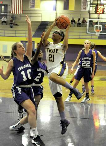 Troy's Alliyah Gillespie drives to the basket during their girl's high school basketball game against CCHS on Wednesday Dec. 3, 2014 in Troy, N.Y.  (Michael P. Farrell/Times Union) Photo: Michael P. Farrell / 00029723A