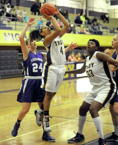 Troy's Kiana Patterson drives to the basket during their girl's high school basketball game against CCHS on Wednesday Dec. 3, 2014 in Troy, N.Y.  (Michael P. Farrell/Times Union) Photo: Michael P. Farrell / 00029723A
