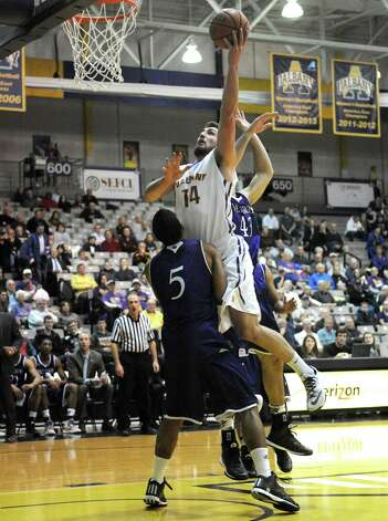UAlbany's Sam Rowley drives to the basket during their men's college basketball game against Holy Cross at the SEFCU Arena on Wednesday Dec. 3, 2014 in Albany, N.Y.  (Michael P. Farrell/Times Union) Photo: Michael P. Farrell / 00029687A