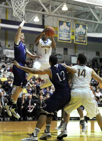 UAlbany's Ray Sanders drives to the basket during their men's college basketball game against Holy Cross at the SEFCU Arena on Wednesday Dec. 3, 2014 in Albany, N.Y.  (Michael P. Farrell/Times Union) Photo: Michael P. Farrell / 00029687A
