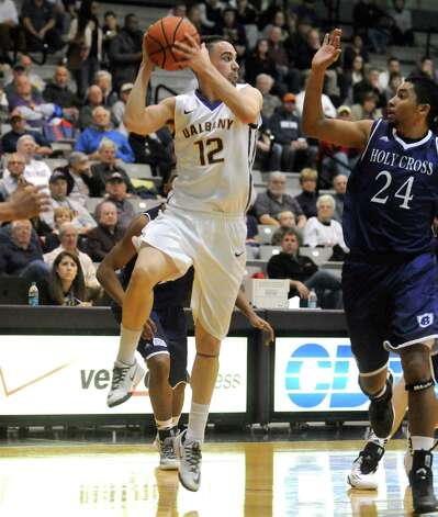 UAlbany's Peter Hooley looks to pass during their men's college basketball game against Holy Cross at the SEFCU Arena on Wednesday Dec. 3, 2014 in Albany, N.Y.  (Michael P. Farrell/Times Union) Photo: Michael P. Farrell / 00029687A