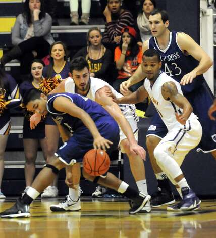 UAlbany takes on Holy Cross in non league basketball game at the SEFCU Arena on Wednesday Dec. 3, 2014 in Albany, N.Y.  (Michael P. Farrell/Times Union) Photo: Michael P. Farrell / 00029687A