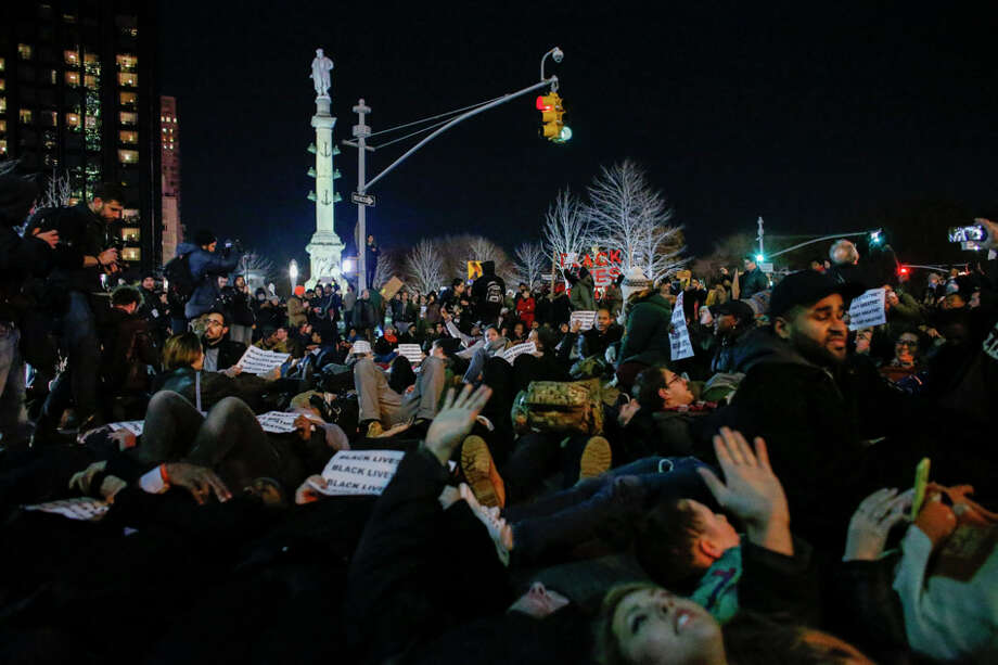 People lie in the street during a protest on New York's Sixth Avenue after a grand jury decided not to indict Police Officer Daniel Pantaleo. Photo: Kena Betancur / Kena Betancur / Getty Images / 2014 Getty Images