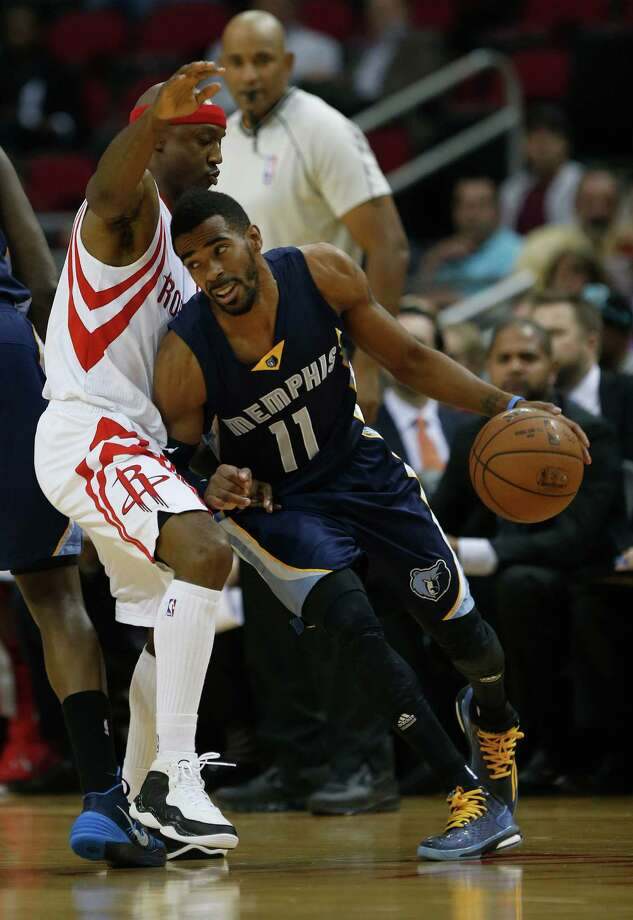 Memphis Grizzlies guard Mike Conley (11) tries to get around Houston Rockets guard Jason Terry (31) in the first half of an MBA basketball game at Toyota Center, Wednesday, Dec. 3, 2014, in Houston.  ( Karen Warren / Houston Chronicle  ) Photo: Karen Warren, Staff / © 2014 Houston Chronicle