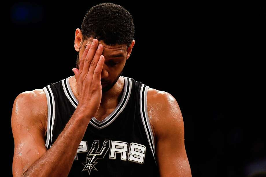 Tim Duncan looks on in the fourth quarter during a game against the Brooklyn Nets. The Nets snapped the Spurs eight-game winning streak with a 95-93 overtime win. Photo: Alex Goodlett, Stringer / Getty Images / 2014 Getty Images