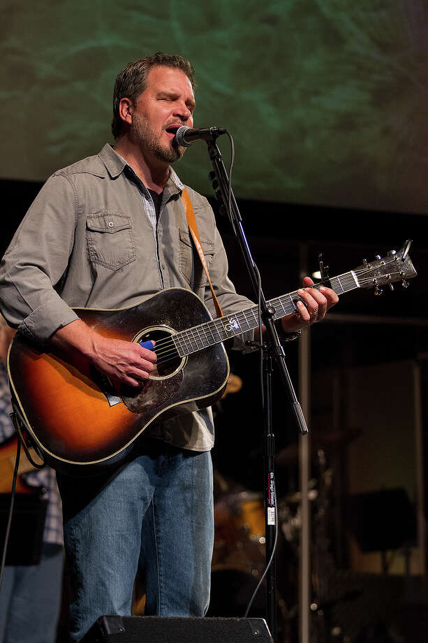 Pastor Sean Azzaro closes a recent service with a song at River City Community Church. He is releasing his debut album Sunday evening at Sam's Burger Joint. Photo: Alma E. Hernandez / Alma E. Hernandez / For The San Antonio Express-News