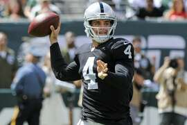 Oakland Raiders quarterback Derek Carr (4) throws a pass during the first half of an NFL football game against the New York Jets Sunday, Sept. 7, 2014, in East Rutherford, N.J. (AP Photo/Bill Kostroun)