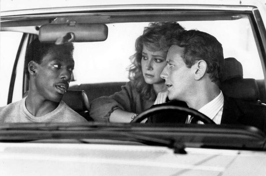 Eddie Murphy, left, Lisa Eilbacher and Judge Reinhold in 'Beverly Hills Cop.' Photo: Paramount Pictures / Houston Chronicle