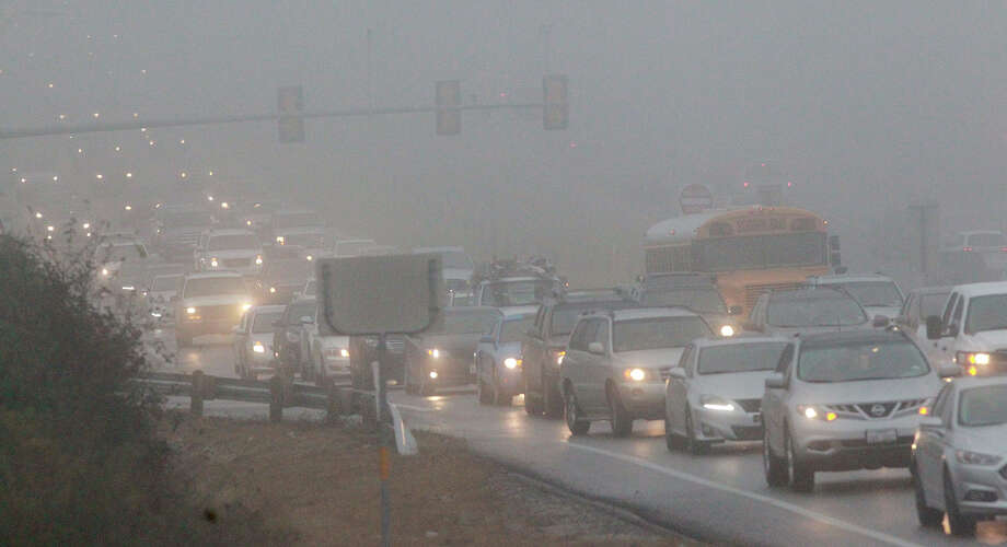 Traffic creeps in foggy conditions Thursday December 4, 2014 on U.S. Highway 281 North near Evans road. Photo: JOHN DAVENPORT, San Antonio Express-News / ©San Antonio Express-News/John Davenport
