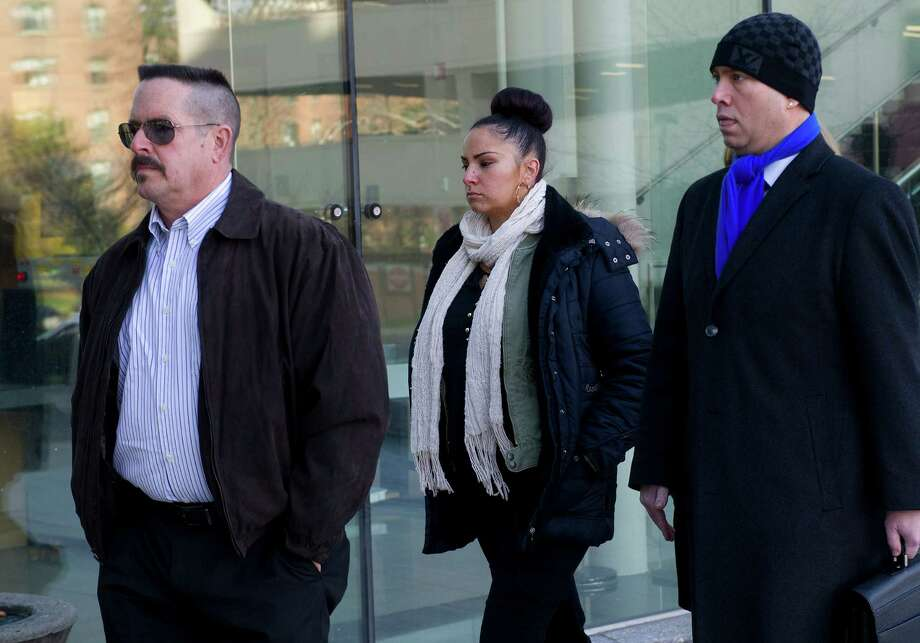 Danielle Watkins enters State Superior Court in Stamford, Conn., on Thursday, December 4, 2014. Watkins, a former English teacher at Stamford High School, is accused of having sex with a student. Photo: Lindsay Perry / Stamford Advocate
